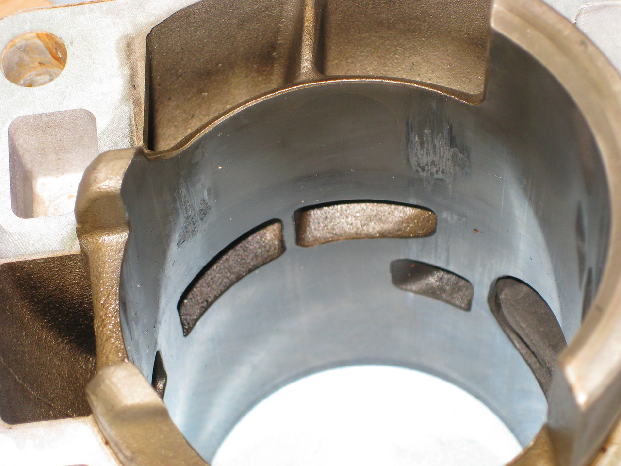 Two of the crunched areas at the bottom of the cylinder