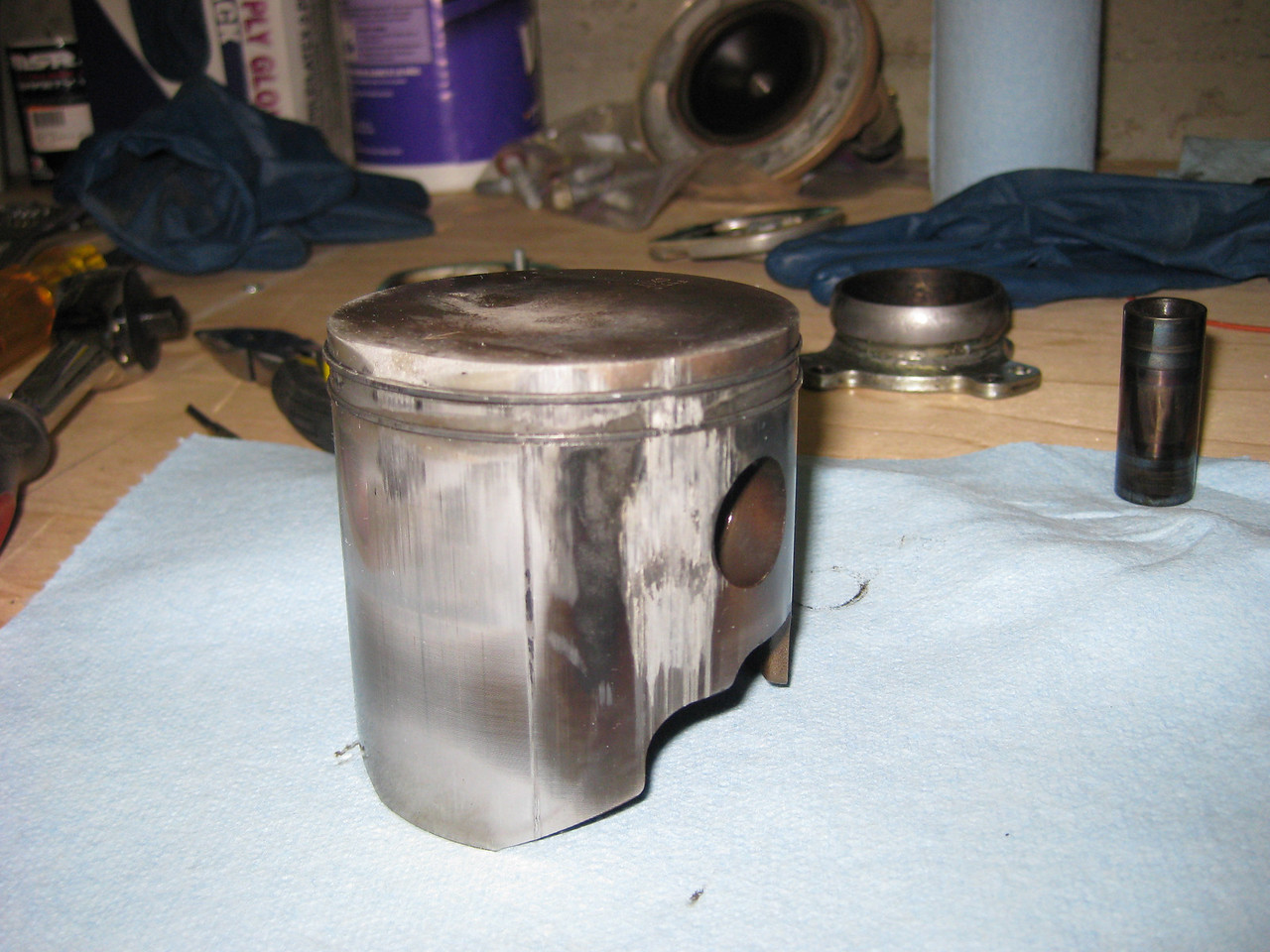 Unhappy piston.  Worn front, and whacked side.