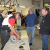 Guy Martin demonstrating valve guides to Scott and Mark