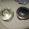 identical pistons - one from the Red Head with 10,000 miles (the clean one) and one from a stock head with 1100 miles (the black one). the stock one had very sloppy valve guides and poor valve clearance causing combustion blow by