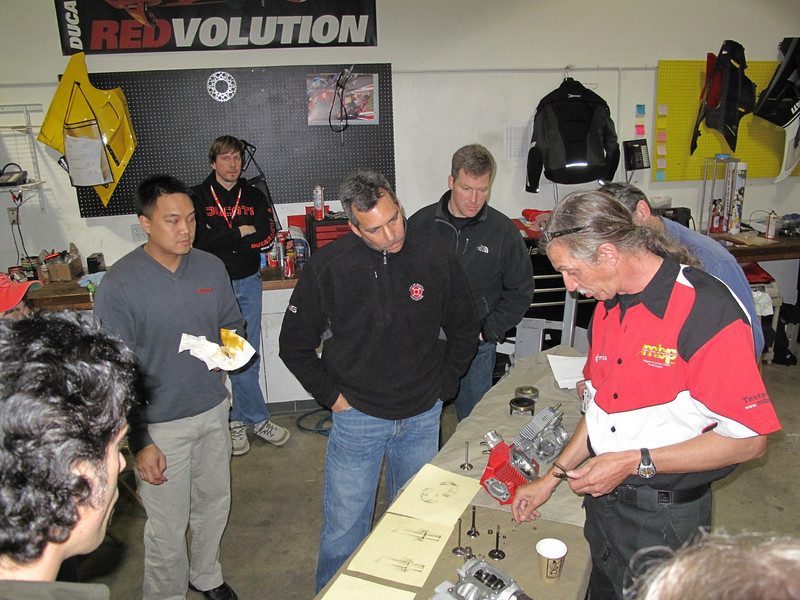 Gathering around Guy Martin the performance guru for some up close explaining of valve clearence and collets