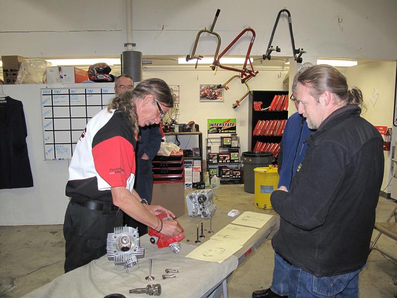 Guy Martin demonstrating valve guides to Scott and Mark