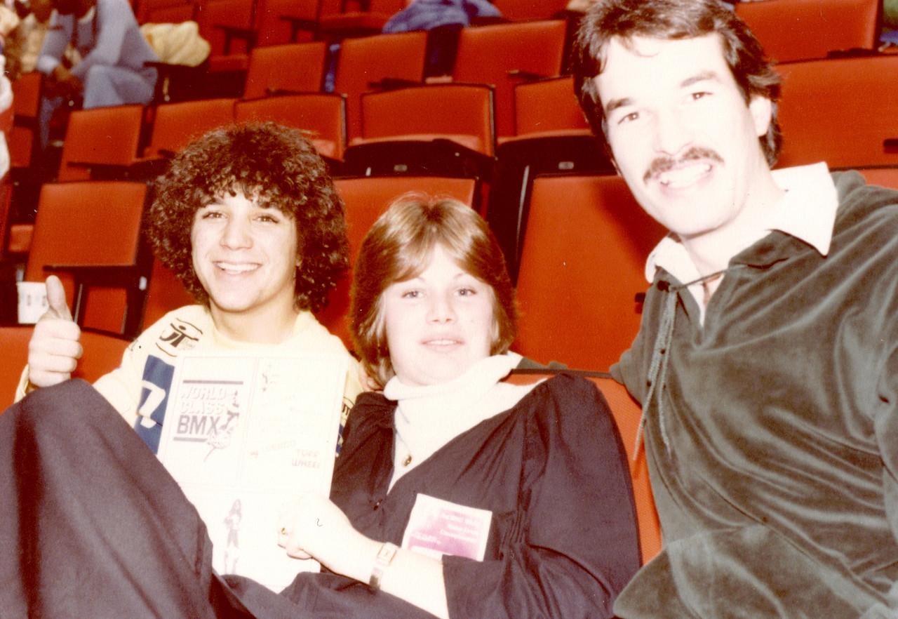 Sal Zuner,Cheri Hanna and Larry Hughey @ Jag BMX 1978<br /> Ms Hanna showing a World Class BMX ad in program