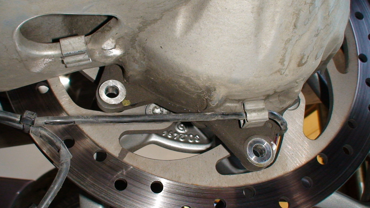 After removing caliper but not cutting wire ties yet. <br /> <br /> note clip for rear speed sensor and brake pad sensor on swingarm.