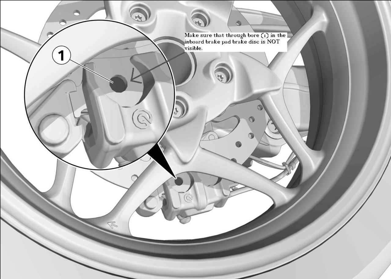 The rear brakes on my GT have two ways of letting you know when it is time for replacement, IN THEORY!<br /> <br /> The first, is an electronic sensor that when the pad friction material is worn to its limit is worn through and breaks a circuit which tells the onboard computer and turns on a warning light and related symbol on the dash board. <br /> <br />                IN THEORY<br /> <br /> The second theoretical way to check for wear limits is holes in the pads that align with holes in the caliper. This SHOULD wear though before all the friction material is worn off the pad so you can visually check if the pads are servicable. <br /> <br /> Another theory disproved!<br /> <br /> I felt that the pads were worn out, but it is hard to see the pads while the caliper is assembled on the bike, so I pulled it off and gave a quick look.