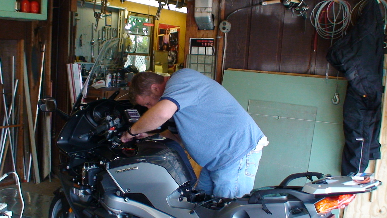 hazard digs around to show me where all the previous wires were on the bike...