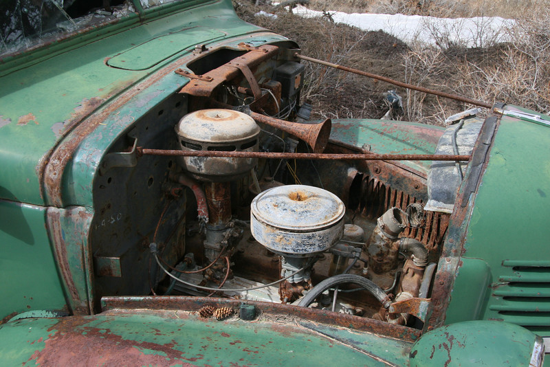Six cylinder engine and oil bath air cleaner.  Some of the rubber hoses were in good shape others had completely decomposed.  Lacquer paint held up well on most of the body.