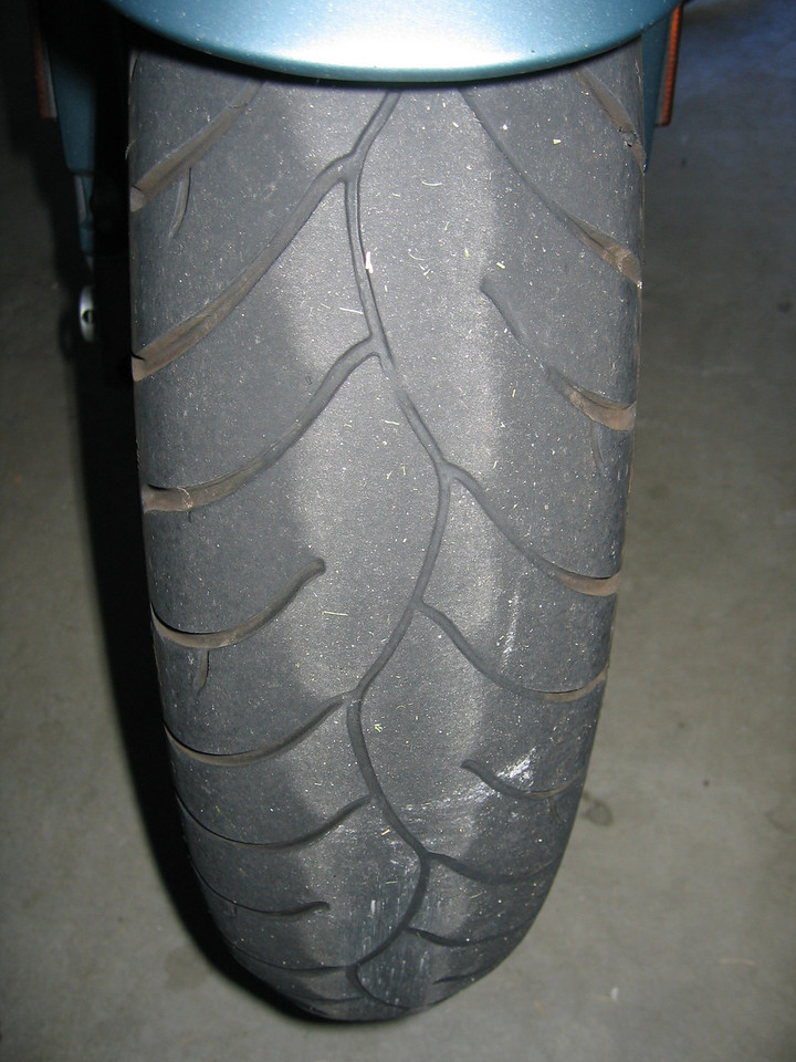 The front tire has a sipe down the center of the tire, and is easier to gauge wear.