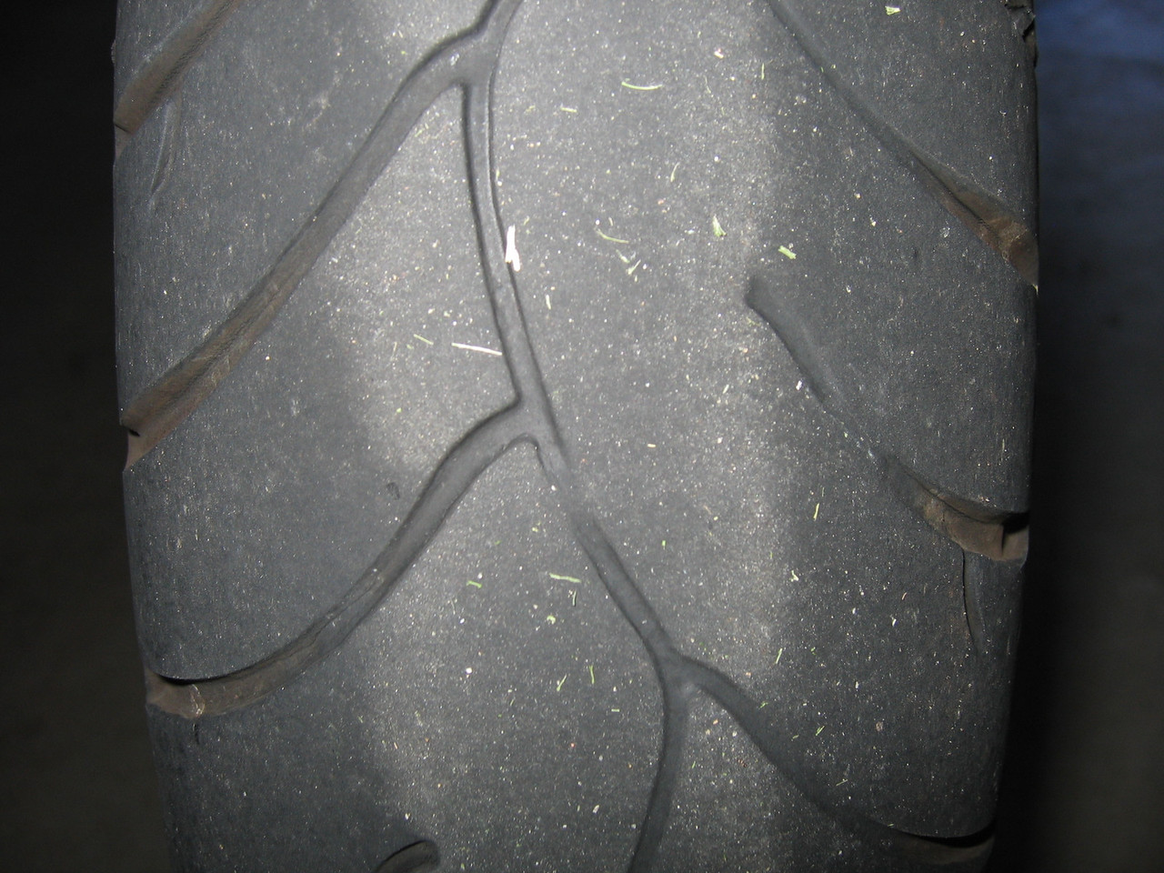 A close up of the wear bars on the front Z6.  This tire is also done.