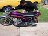 "This is Mike showing me one of his bikes. This is a tricked out 1973 Kawasaki H2 750, with a stage one Gast motor,125hp at crank,100 hp at wheel.Dual front discs, Lectron Carbs,Rask rearsets,Magura clipons,,expansion chambers.Awesome machine,hideously quick and well sorted,one of the best They call these bikes ""widow makers' for good reason."