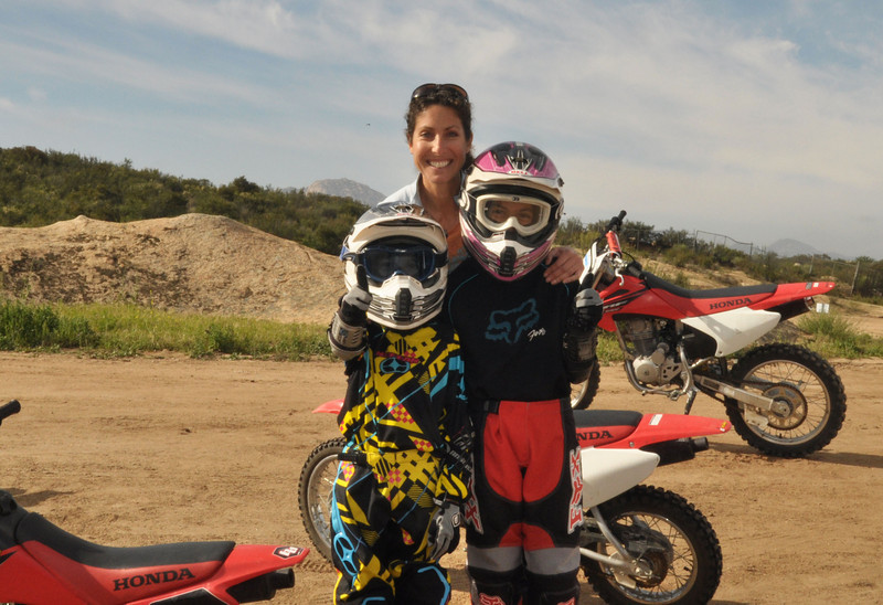 Proud mama with her adventurous children Dimitri, age seven, and Alana, age ten, in their off-road motorcycle class at Coach2Ride.
