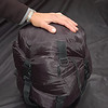A compression sack condenses two down sleeping bags into the space of one.