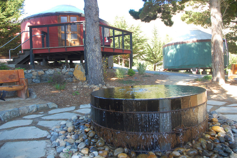 This meditative fountain is a focul centerpiece between a cluster of quality built yurt cabins.