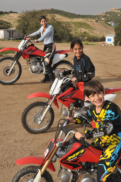 Similar grins show how motorcycling makes them feel.