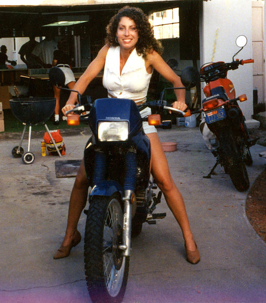 Nicole's first bike in '93, a Honda NX250, brings a smile to her face because of its fun and reliability.