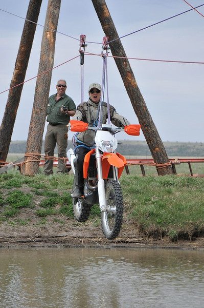 Roseann Hanson, founder of Overland Expo, offers to test the winching and recovery abilities of the Camel Trophy team.