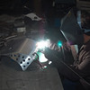 Steve's Plating welder puts the finishing welding touches on the Rugged Rider DRZ skid plate.