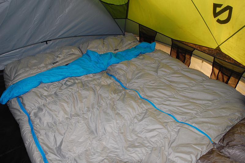 Zipping together two Nemo Strato Loft sleeping bags creates a two-in-one down bed.