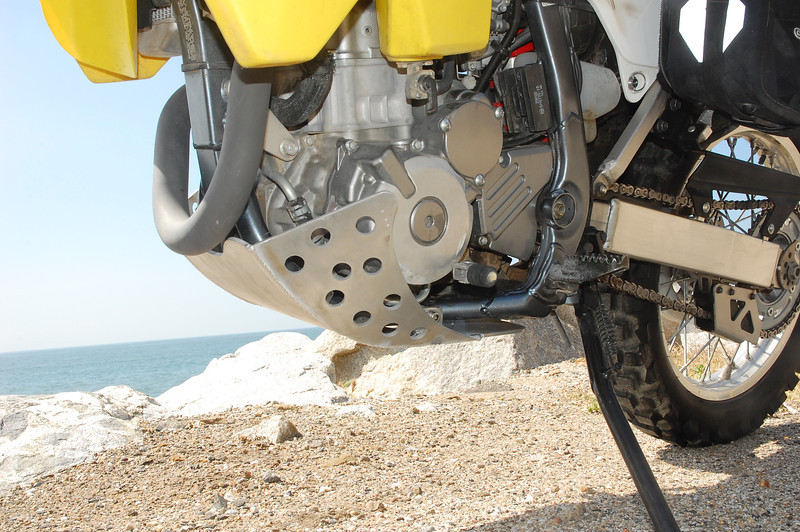 The Rugged Rider skid plate attaches with the OEM side mounts to keep it off the rails.