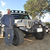 Mike Spencer, general manager for BMW Ventura, shows off his Rubicon Jeep that helped save the day.
