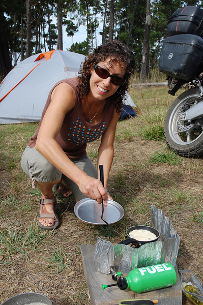 Nicole flips a pancake with rehydrated blueberries.