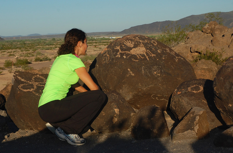 Nicole touches history at the petroglyph site at Painted Rock in southern Arizona.
