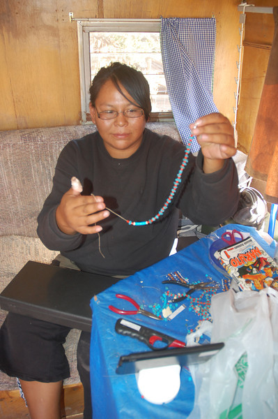 Charlend shows me the Navajo jewelry that she makes from scratch.