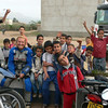 Hana Ptackova of MotoAdvenTours finds herself happily adrift in a sea of local children on one of her tours.