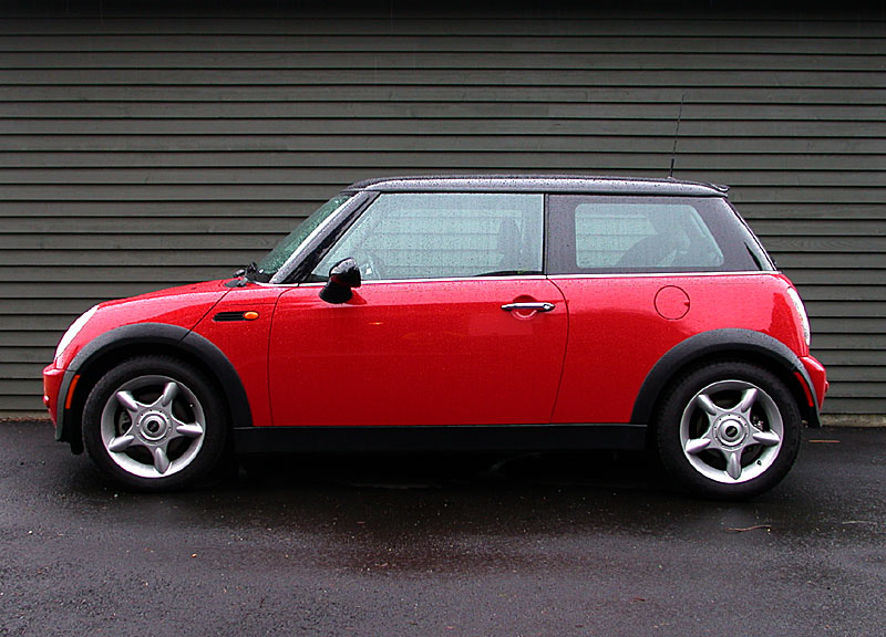 <b>Our Mini Cooper</b><br>The family car. Fits two tall people in front and two toddlers in car seats in the rear, we can say.