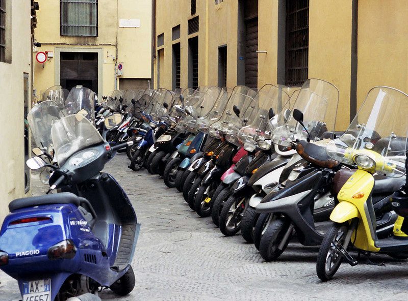 <b>Scooters in Florence II</b><br>Imagine how much space the same number of automobiles would occupy! And each of these vehicles provides a similar on-demand transportation solution.