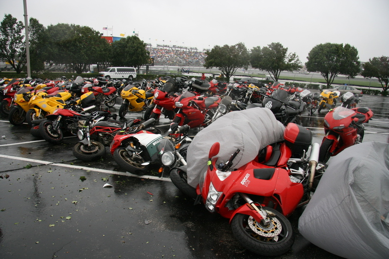 Photo - Indianapolis Moto GP: Ducati Island parking lot just out front of the IMS Museum.<br /> Ducati motorcycles, just like sheep.....Ya get one ducati to fall over and they all have to follow :-)<br /> Indianapolis Moto GP and Hurricane Ike was the culprit