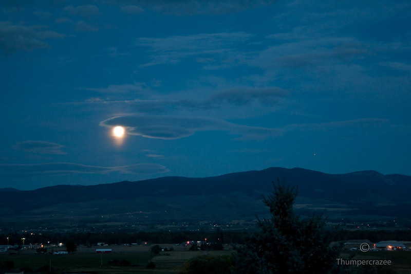 This photo was taken later showing the Moon with Jupiter slightly visible to the right and just above the mountains