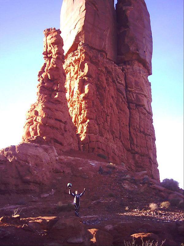 Me, standing beneath a large phallic symbol