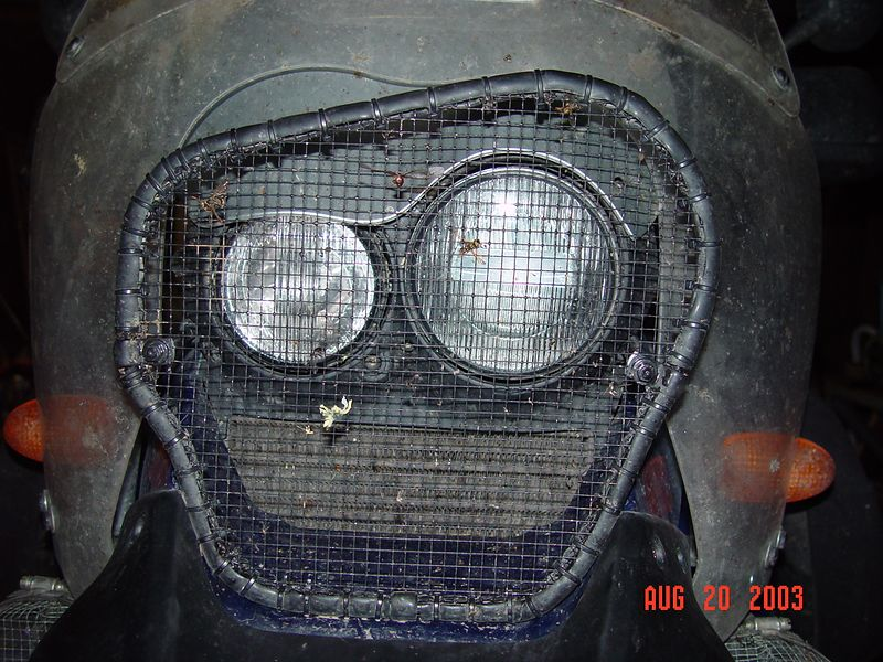 This is my new and much improved rock and bug screen used to protect the headlights and the oil cooler from wild life and debris.  It is much stronger and flows more air then any other such shield I have made or seen sold by an aftermarket company.  Because it is mounted three inches in front of the lights, it allows the lights and the oil cooler to be easily cleaned.