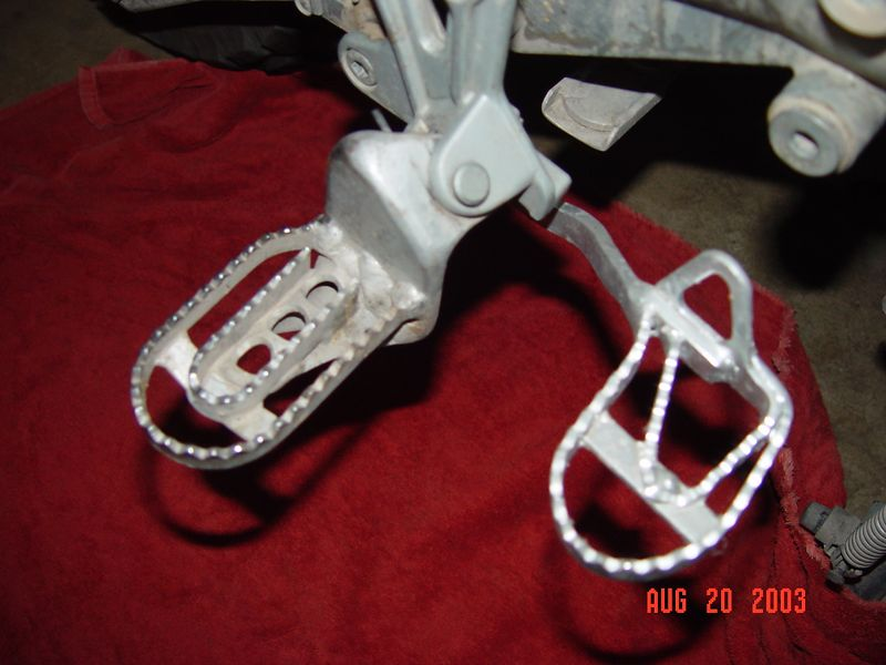 These are the foot pegs and rear brake pedal on my R1150GS, I have made the same modifications on the R80G/S.  The foot pegs have been lowered two inches from the stock location, the foot pegs and the rear brake pedal have also been made much wider then stock, this allows for ease of standing on the pegs when riding in adverse terrain and ease of finding the brake pedal when the pucker factor is excessive.