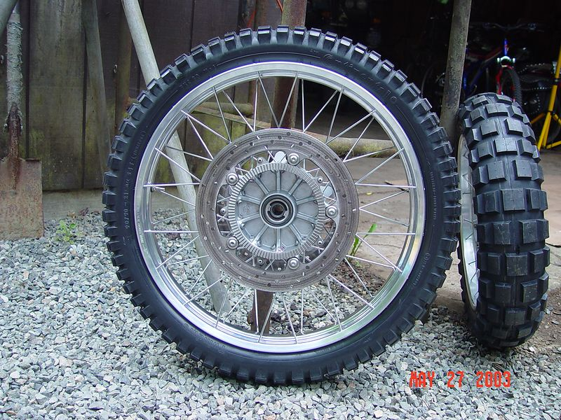 This is the 21 inch wheel I had built for the front of my R1150GS.  It is shown here with a TKC-80 tire mounted on it, along side of it is the rear wheel, it also has a TKC-80 tire.  This tire and wheel combination works very well in the off road environment and does a respectable job on road.