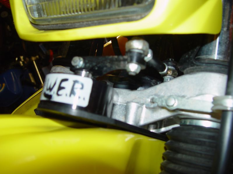 Here is the W.E.R. steering dampener, this is one of the BEST modifications I have made to the bike.  It makes the bike easier and safer to ride in the nasty stuff.