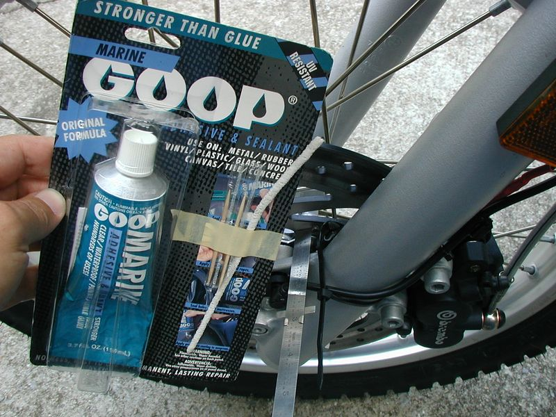 Marine Goop should hold the sensor to the left fork leg. Chosen for it's waterproof-ness.