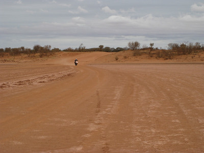 On the road out from Tibooburra to Camerons Corner crossing a clay pan.