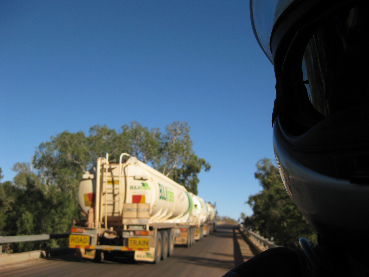 Being passed on a bridge by a road train while taking a photo. Nearly got bumped off the bridge.