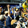 The Rossi phenom, a crush of cameras, cheers, sharpies and souvineers to sign every time he walkd through the paddock.