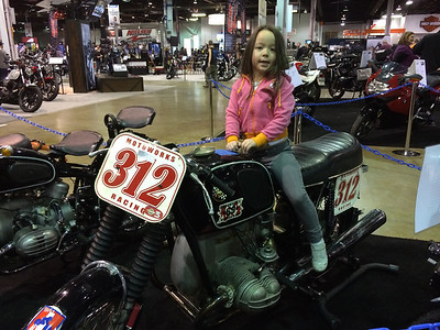 Keira riding Johnny Scheff's Vintage BMW Racebike