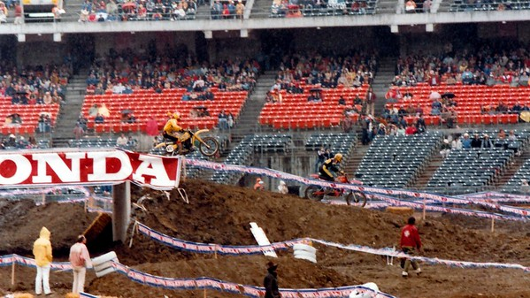 """Me on the """"big"""" jump. The spectators trying to stay out of the rain."""