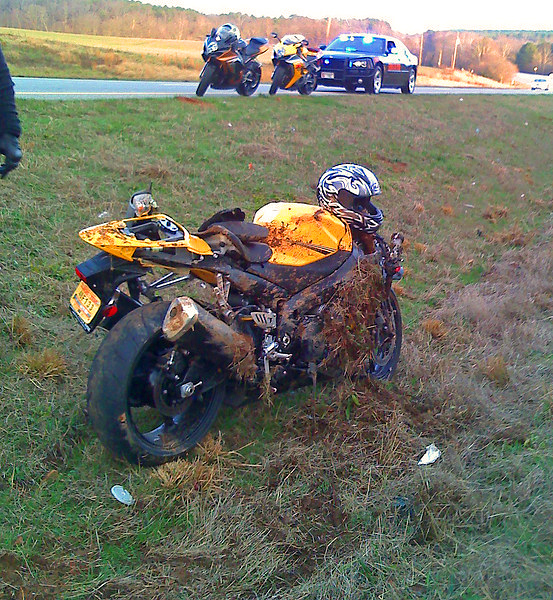 130 mph crash on a 08 Gixxer 1000 (stolen) with 906 miles on it after he couldnt make the curve, he went off into the median, crashed, slid and flipped nearly 1/8 mile before stopping where these pics were taken (cell phone pics..sorry).. <br /> .. <br /> <br /> THESE BIKES ARENT A JOKE!! RIDE WITHIN YOUR ABILITIES.DONT LET YOUR EGO OVERLOAD YOUR ASS AND GET YOURSELF KILLED OR KILL SOMEONE ELSE..<br /> <br /> The guy riding the bike was on the way to the hospital when<br /> I took these pics with my cell phone.