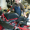 Chris Cosentino and the single-cylinder race bike he designed and built.