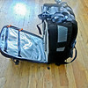 """On the sides are mesh pockets for water bottles, etc. and the strap is for adding LowePro """"slip lock"""" accessory pouches, for small items, cell phones, etc."""