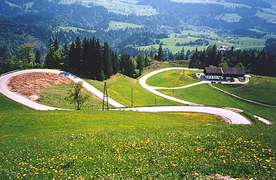 May 25, 1995 - Postalm Strasse, near Wolfgangsee, Austria.<br /> <br /> Taken from the Leierhof (1025 m asl), this section of road lies between the Postalm Strasse plateau and the town of Rigausau. It's times like this that I wished I had my Suzuki RG500 Gamma instead of my BMW R65. These turns are almost endless.