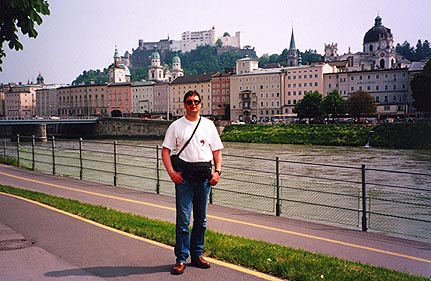 """May 26, 1995 - Salzburg, Austria.<br /> <br /> This view is taken from Elisabethkai next to the Makartsteg pedestrian bridge that takes you to the other side of the Salzach river. In the near background is the old part of Salzburg. Festung Hohensalzburg (castle) is situated on the top of Mönchsberg and can be reached either on foot or by the Festungsbahn, a cogged rail car. This castle has been featured on """"Great Castles of Europe"""" on one of the cable channels."""