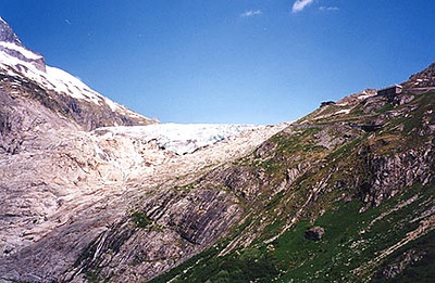 June 10, 1996 - On the west ramp of the Furkapass, Switzerland.  The Rhonegletscher can be seen in the center. The Gletschergrotte and Hotel Belvedere are situated on the mountain side in the upper right.