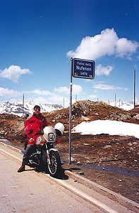 June 11, 1996 - Passo della Novena a.k.a. Nufenenpass, Switzerland.  The Nufenenpass (2478 m asl) lies between the towns of Airolo and Ulrichen. I found this pass to be more barren than the others and the power lines took away from the landscape. Other than that, the views were great as is usual. A right turn in the town of Ulrichen leads back to the town of Gletsch. From there you have a choice of either the Furkapass or the Grimselpass. The five passes are arranged in a vertical figure eight. You can easily do them in a day if you don't stop often, but two days gives you more time to enjoy them.